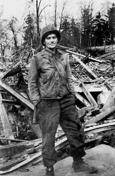 Pfc. John Rison Jones  amid the destruction of the war. Courtesy of UAHuntsville Salmon  Library.
